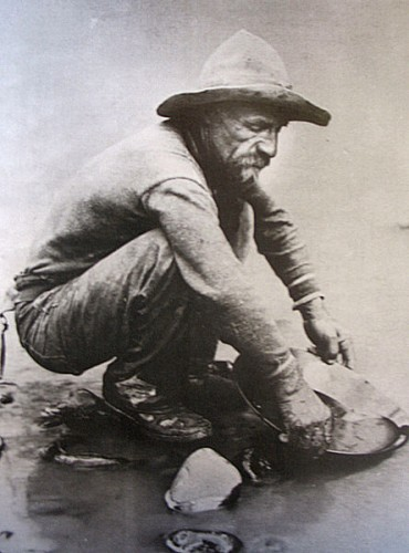 Public domain image of man panning for gold